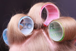 Female blond hair head curlers rollers hairdresser beauty salon