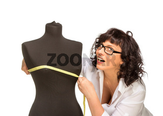 Adult tailor with mannequin