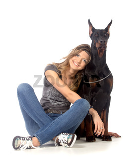 Young woman with black dobermann dog