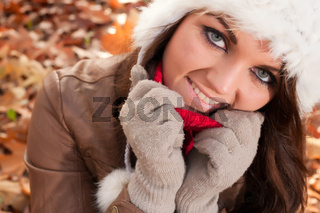 Smiling woman  with leafs