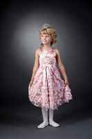 Little dancer posing in pink dress and diadem