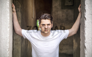 Young man with arms open on threshold