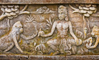 Old bas-relief on the wall of the temple. Indonesia, Bali