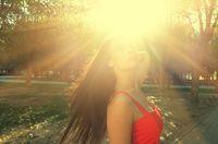 Long haired women backlit by sun