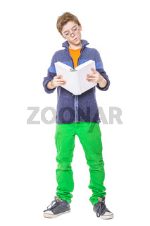 standing teenager with glasses reading a book, isolated on white