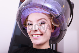 Smiling woman hair rollers curlers hairdryer hairdressing beauty salon