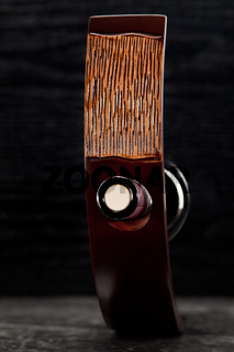 Red wine bottle in luxury holder
