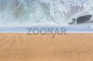 Sandy beach with waves in the distance