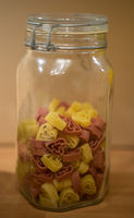 Dried heart-shaped pasta in a storage jar
