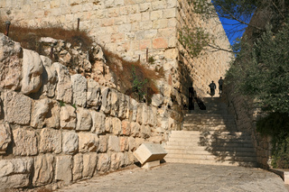 Two religious Jews up the ancient stone