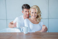 Middle Age Lovers in Coffee Time Looking at Camera