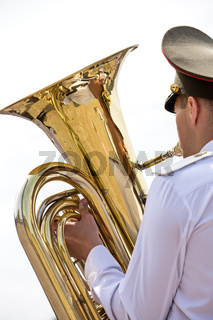 Tuba player in military orchestra