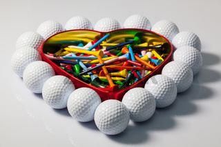 Heart of golf balls and tees