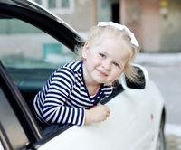 little girl  sitting in a car