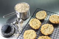 Freshly baked oatmeal cookies on cooling rack