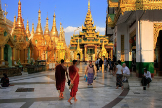 Pilgrims walking around Temples of Shwedagon Pagoda complex, Yangon, Myanmar