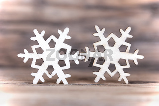 Two Snowflakes on Wood