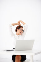 Happy Office Woman Stretching in front her Laptop