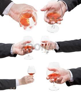 set of brandy glasses in businessman hand