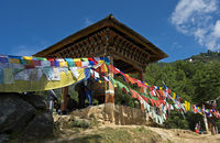 Buddhist prayer flags at a prayer mill