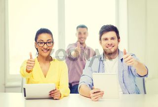 smiling team with tablet pc computers at office