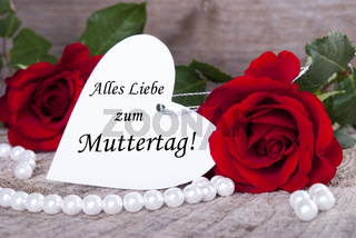 Heart Label with the German Words Alles Liebe zum Muttertag which means Happy Mothers Day and Roses