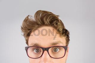 Geeky businessman looking at camera
