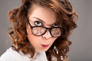 surprised woman in glasses