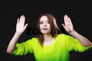 teen girl making stop gesture on black