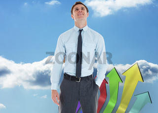 Composite image of smiling businessman standing with hand in pocket