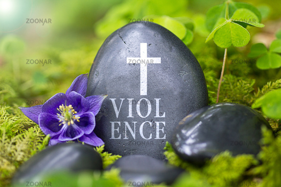"""Black stone with the Word """"Violence"""""""