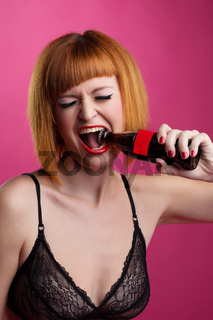 Cute redhead girl opens bottle by her mouth