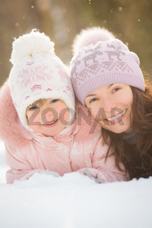 Happy family lying on snow