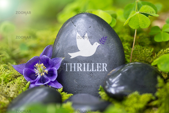 """Black stone with the Word """"Thriller"""""""