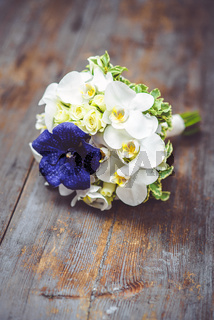 Beautiful bridal bouquet with orchids and roses