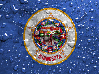 flag of Minnesota with rain drops