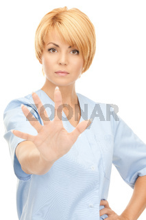 attractive female doctor showing stop gesture