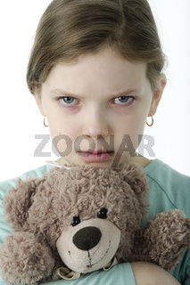 Portrait of  little girls cry holding teddy bear isolated on white