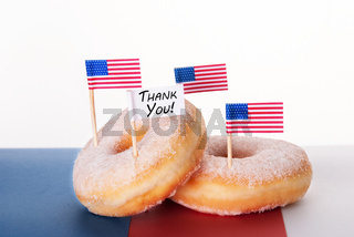 Four Donuts with American Flags and a Thank You Flag
