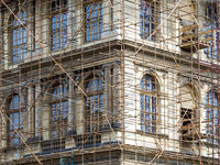 Fragment of scaffolding against house wall in Prague
