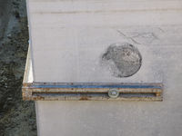 Iron angle outside on concrete wall