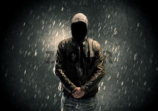 Unknown suspect standing in the dark