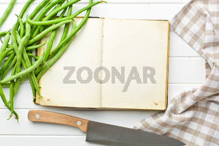 blank recipe book and green beans