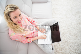 Beautiful blonde woman using laptop
