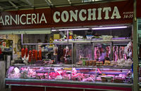 Stalls for meat and sausages at the green market, Granada, Spain