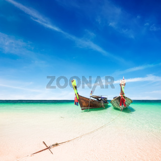 Thai traditional wooden boat at ocean shore Thailand