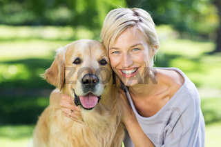Pretty blonde with her dog in the park