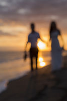 Blurred couple on beach