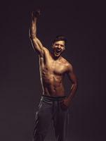 Athletic young man posing, studio shot