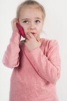 Little girl talking on cellphone